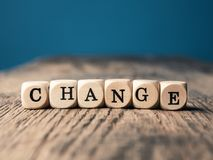 The word Change on small dices. Small wooden dices with the word Change on an office table stock images