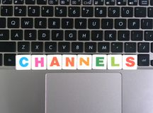 Word Channels on keyboard background.  stock images
