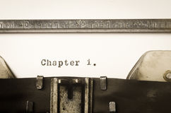 Word chapter 1 written on typewriter Stock Images