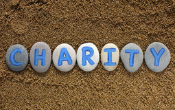 Word Charity spell out from stones Royalty Free Stock Photos