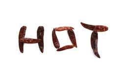 Word CHAUD avec le piment sec Photo stock
