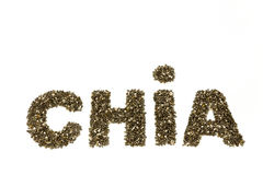 Word CHIA made of chia seeds. Word CHIA containing chia seeds isolated on white background Royalty Free Stock Photos