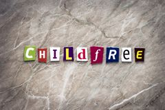 Word child free of cut letters on brown background. Ideology concept. Headline, writing text child-free on the banner. Abstract ca stock photo