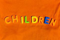 The word Children composed from letters. The word Children composed from colorful children toy big letters on the grass stock photo