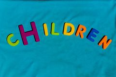 The word Children composed from letters. The word Children composed from colorful children toy big letters on the grass royalty free stock photography