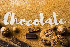 The word chocolate among cocoa with sweets