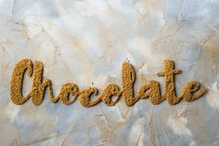 The word chocolate is written in cocoa