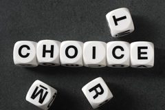 Word choice on toy cubes. Word choice on white toy cubes Royalty Free Stock Photo