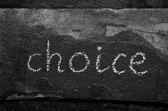 The word CHOICE written with chalk on black stone.  Stock Image