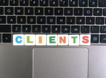 Word Clients on keyboard background.  stock photos