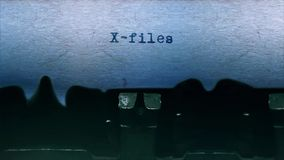 X-files Word  Typing  Centered on a Sheet of paper on old Typewriter audio. Word closeup Being Typing With Sound and Centered on a Sheet of paper on old stock footage