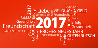 Word cloud with new year 2017 greetings. And red background (text in german Royalty Free Stock Photo
