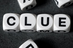 Word clue on toy cubes. Word clue on white toy cubes Stock Photography