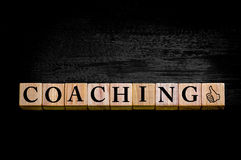 Word COACHING isolated on black background Stock Photography