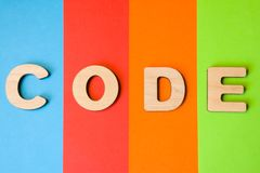 Word code is composed of 3D letters is in background of 4 colors: blue, red, orange and green. Illustration of code language for p stock photography