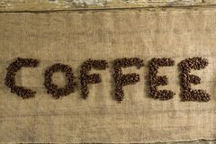 Word coffee arranged with coffee beans Royalty Free Stock Photos