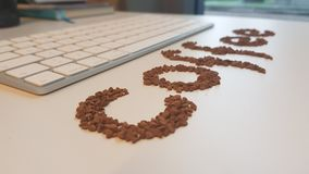 Coffee Beans Text. Word with Coffee Beans and keyboard Stock Photos