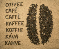 Word coffee with coffee bean. Word coffee made of coffee beans in various languages: english, french, spanish, portuguese, german, dutch, czech, slovak and royalty free stock photos
