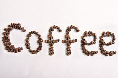 The word coffee from coffee beans Stock Photos