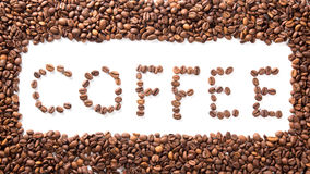 Word coffee in frame, roasted beans over white Royalty Free Stock Photography