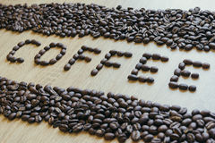 Word coffee made from coffee beans with borders Stock Photography
