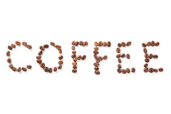 Word coffee, roasted beans over white background Royalty Free Stock Photos