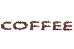 Word Coffee spelled with coffee beans on white. Word Coffee spelled with brown roasted fresh coffee beans on white with copy space above and below as a design Royalty Free Stock Photos
