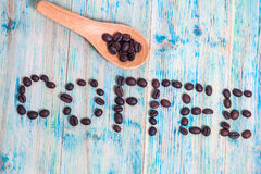 The word Coffee spelled with coffee beans Stock Photos