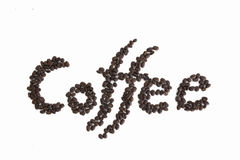 The word Coffee spelled with hundreds of coffee beans. Isolated. Against on white background Stock Photography