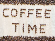 Word coffee time made from coffee beans. With borders, from above view Stock Photography