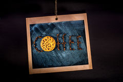 Word coffee written with coffee beans and oatcake Royalty Free Stock Photos