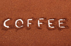 Word coffee written on ground coffee Royalty Free Stock Images