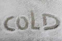 The word cold in the snow Royalty Free Stock Images