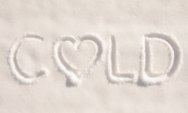 Word cold written in snow, with a heart Royalty Free Stock Photography