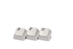 Word collected from computer keypad buttons SEO isolated Stock Photos