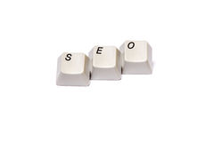Word collected from computer keypad buttons SEO isolated Stock Images