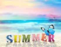Word of color letters on summer beach and butterfly. Summer beach. Word summer of color letters on summer beach and butterfly on a background of ocean royalty free stock images