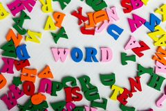 The word word from the colorful wooden letters. On a white wooden background Royalty Free Stock Images