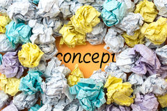 A word comcept among crumpled paper sheets Royalty Free Stock Images
