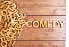 Word comedy made with wooden letters Stock Photo