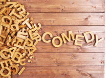 Word comedy made with wooden letters Stock Images