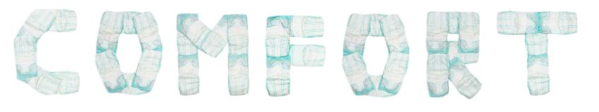 Word comfort laid out baby diapers on a white background, isolate, napkin, inscription stock photo