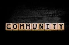 Word COMMUNITY  isolated on black background Stock Image