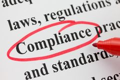 Word Compliance Circled in Red Pen Closeup Royalty Free Stock Photo