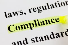 Word Compliance with Highlighter. Yellow highligher marking the word compliance Stock Photo