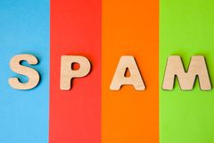 Word, concept or abbreviation SPAM photo. Word SPAM composed of 3D letters in background of four colors-blue, red, orange and gree royalty free stock images