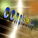 Word `consistency` write on reflecting abstract aluminum plate. Royalty Free Stock Image