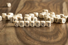Word CONTENT on wooden cubes Stock Photos