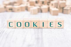The Word Cookies Formed By Wooden Blocks On A White Table royalty free stock images