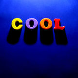 The Word Cool on Blue Background Stock Photography